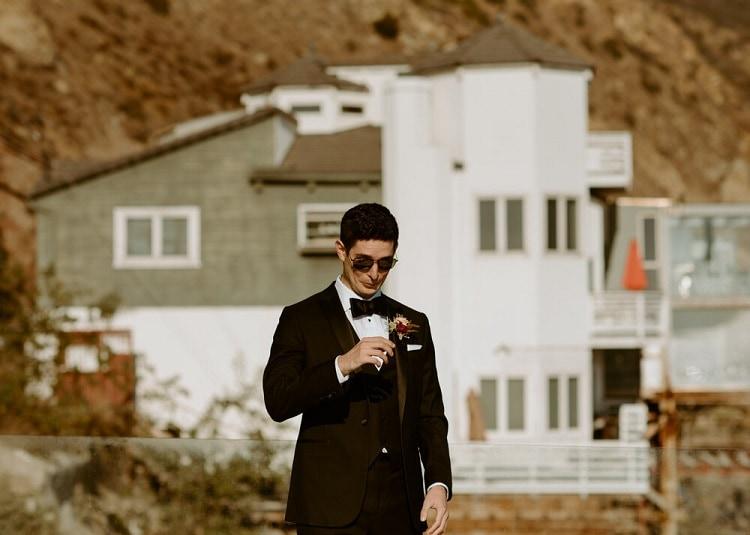 nicole12-jamie-carrie-rogers-photography-malibu-intimate-beach-elopement-california-destination-wedding-outdoor-coast-ceremony-groom